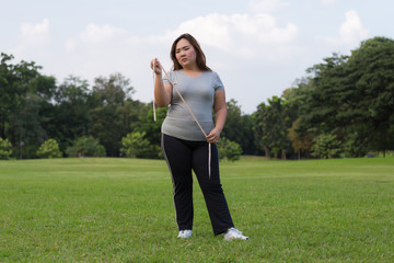 obese women is worrying about her overweight