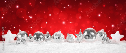 canvas print picture silver Baubles on snow with red sparkle background