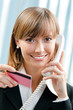 Businesswoman with phone and credit card