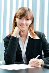 Businesswoman working with document at office