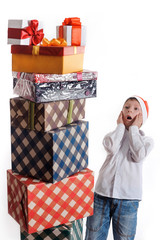 surprised boy and christmas presents