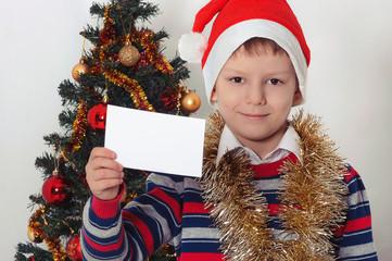 boy holding greeting card. Christmastime