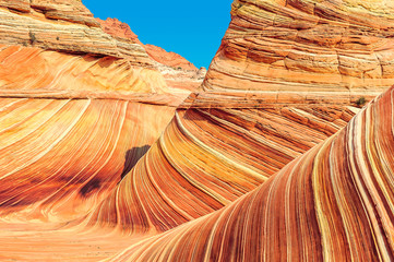 Plateau  from red sandstone in the form of ocean waves.