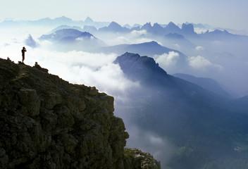 Climber photographing breathtaking mountain panorama