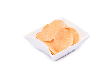 crisps potato chips on white plate Isolated