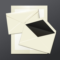 Blank white envelopes opened, close, and a letter template
