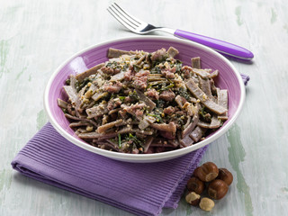 pizzocheri with sausage spinach and hazelnut