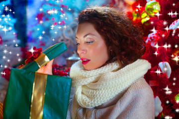 curious woman opens Christmas gift