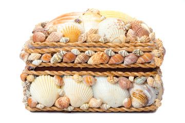 Chest made of seashells isolated on white