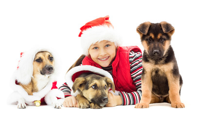 Happy kid in Christmas hat and puppy on a white background isola