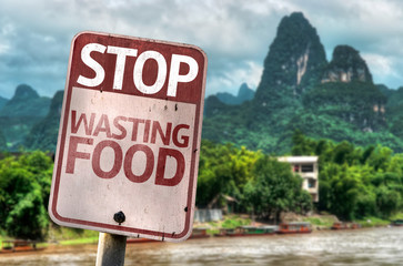 Stop Wasting Food sign with a forest background