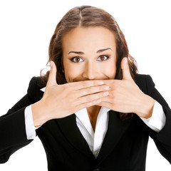 Happy businesswoman covering mouth, isolated