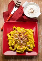 chicken stew with saffron cream sauce and bacon
