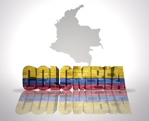 Word Colombia on a map background