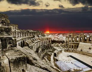Roman amphitheatre in the city of El JEM in Tunisia amid colorfu
