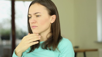 Sick young woman is coughing, close up