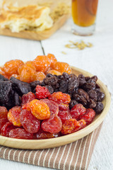 Heap of Various Dried Fruits in Brown Wooden Plate