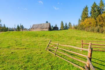 Wooden fence on green field, Pieniny Mountains, Poland