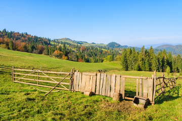 Pen for sheep on green field, Pieniny Mountains, Poland