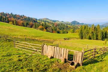Pen for sheep on green field, Pieniny Mountains, Poland