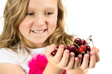 Little girl with cherries