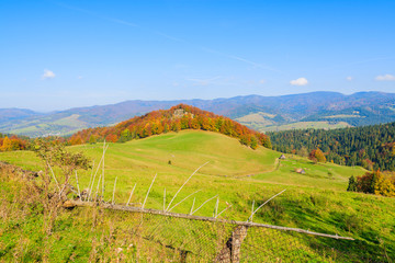 Fence on green field on in autumn day,Pieniny Mountains, Poland