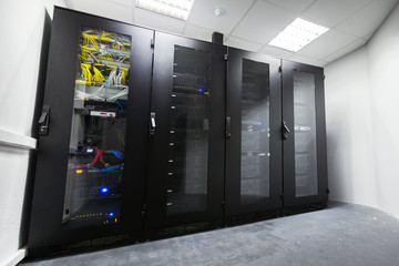 Modern server room with black computer cabinets
