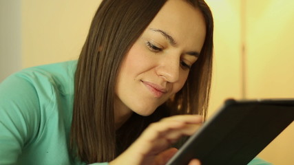 Smiling young woman with tablet pc, close up