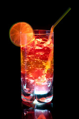 colourful coctail on the black background.