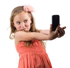 Little girl doing photo of her self