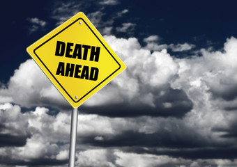 Death ahead sign over cloudy sky