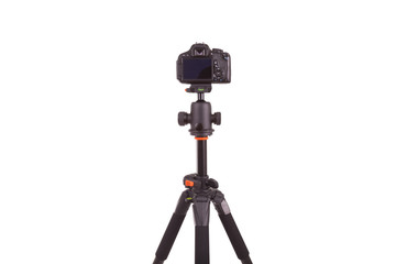 Digital camera mounted on tripod, isolated on white background