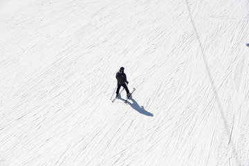 Skier going down the slope at ski resort