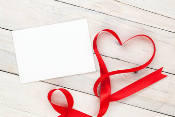 Photo frame or greeting card and valentines heart shaped ribbon