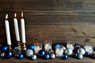 Blue and silver ornament balls with candles