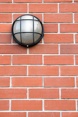 glass lantern on the red brick wall