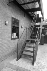 Steel ladder with red brick wall