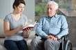 Senior care assistant reading book
