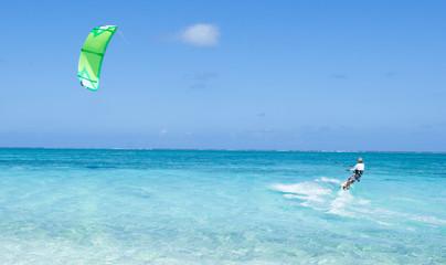 Kitesurfing on clear blue tropical water, Okinawa, Japan