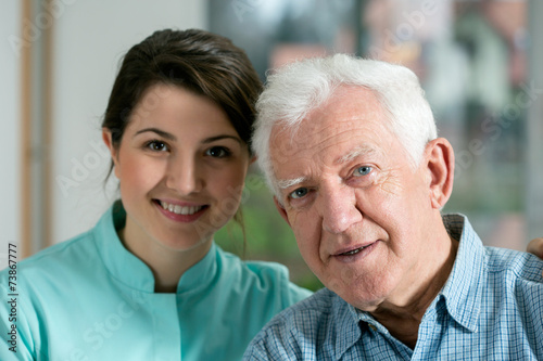 canvas print picture Smiling senior man and young nurse