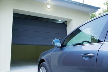 Car near the automatic garage door