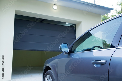 Car near the automatic garage door - 73868101