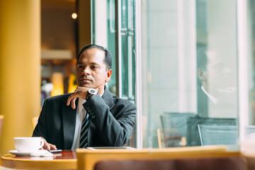 Pensive Indian businessman