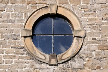 Round window in a stone frame © Arena Photo UK