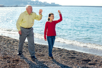 The old man walked by the sea with granddaughter