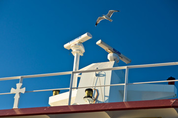 Seagulls in low flight over the ferry near Thassos island