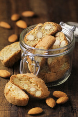 Italian Almond cantuccini in a glass jar on wood