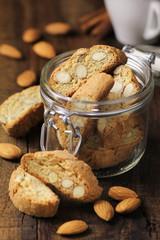 Italian Almond cantuccini in a glass jar with coffee