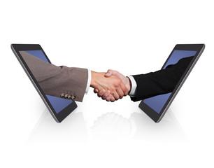 Business Handshake Emerging From Digital Tablets