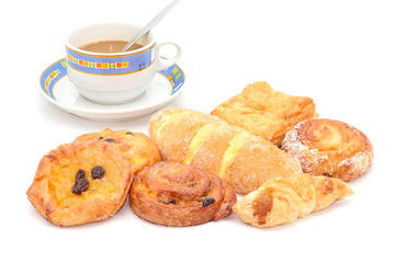 Variety of bread with coffee on white background